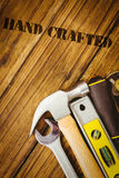 Hand crafted against desk with tools Stock Photo