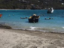 Hand-crafted boats bobbing in the surf at friendship bay, bequia stock video footage