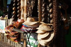Hand crafted buri hats, fan, bamboo and coconut home decoration are displayed along the street. stock photography
