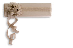 Hand crafted Christmas gift with burlap bow Stock Photos