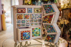 Hand crafted colorfull wooden cupboard stock photography