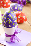 Hand crafted easter eggs on the wooden  table Royalty Free Stock Images