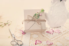 Hand crafted gift box with flower petals Stock Photography