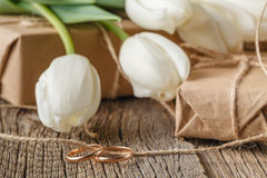 Hand crafted gift box and tulips stock photos