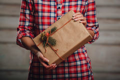 Hand crafted gift box in woman hands Stock Photo