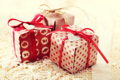 Hand-crafted gift boxes with heart-shaped labels Royalty Free Stock Photography
