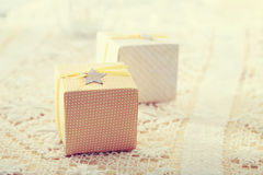 Hand-crafted gift boxes with star-shaped labels Royalty Free Stock Photo