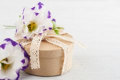 Hand crafted gift and flowers Royalty Free Stock Photography
