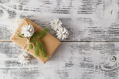 Hand crafted gift on rustic wooden background with with fir bran royalty free stock images