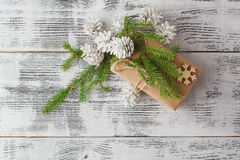 Hand crafted gift on rustic wooden background with with fir bran stock images