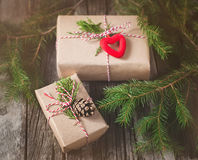 Hand crafted gift on rustic wooden background with with fir branches and cones Royalty Free Stock Photo