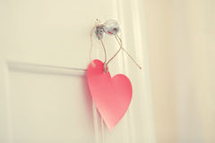 Hand crafted heart hanging from door knob Royalty Free Stock Photo