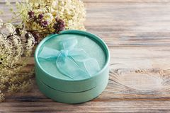 Hand crafted min green gift with bow, flower Royalty Free Stock Image