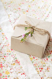 Hand crafted present box. With wax flowers royalty free stock images