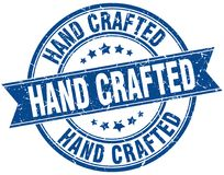 Hand crafted stamp. Hand crafted round grunge ribbon stamp on white background royalty free illustration