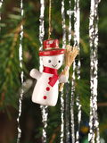 Hand crafted traditional Christmas tree decoration Snowman hanging on  a tree branch Stock Photo