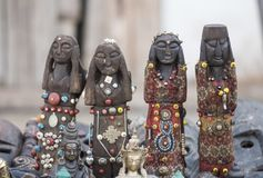 Hand crafted traditional wooden human statue in a row Royalty Free Stock Photos