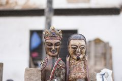 Hand crafted traditional wooden human statue in a row Stock Photography