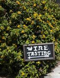 A wine tasting sign points the way. Royalty Free Stock Images