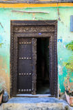 Hand crafted wooden door at Zanzibar Stock Image