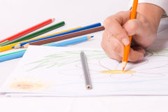 Hand with crayon sketching a flower. #2 Royalty Free Stock Photos
