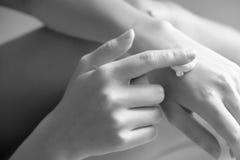 Hand cream black and white stock photos