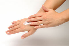 Hand cream on hand. The hand is daubing another hand with hand cream Stock Image