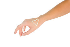 Hand with cream heart. Isolated on white background Royalty Free Stock Photography