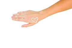 Hand with cream heart. Isolated on white background Stock Photo