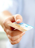 Hand with credit card. Shallow DOF Stock Images