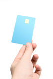 Hand with credit card. Isolated on white (focus on card stock images