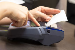 Hand With Credit Card Swipe Through Terminal Stock Photography