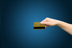 Hand with credit card. Symbolizes the payment .Composition with blank space on left royalty free stock images