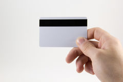 Hand with a credit card on a white background.  royalty free stock photo