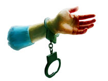 A hand of the criminal in handcuffs. Crime a hand of the criminal in handcuffs on a white background Stock Image