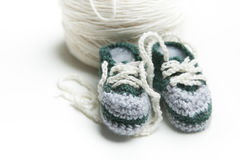 Hand crocheted baby shoes with wool Royalty Free Stock Images