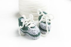 Hand crocheted baby shoes with wool Stock Images