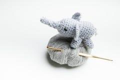 Hand crocheted elephant with wool, crochet needle Stock Photo