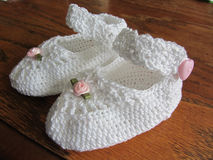 Hand Crocheted Lacy Girl Baby Booties Stock Photography
