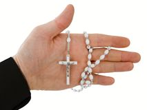 Hand with a cross. Hand holding Catholic rosary beads Royalty Free Stock Images