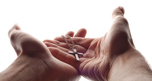 Hand and cross stock photo