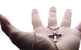 Hand and cross Royalty Free Stock Photography