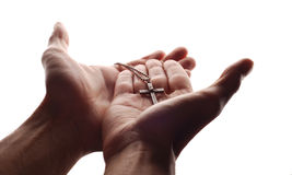 Hand and cross royalty free stock photo