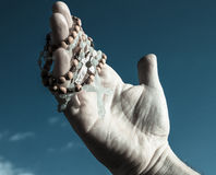 Hand with crucifix Stock Photography