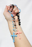 Hand with crucifix Royalty Free Stock Images