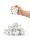 Hand and crumpled paper Stock Images