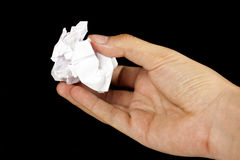 Hand with a crumpled paper bal Royalty Free Stock Photography