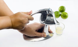 Hand with crush stainless lemon juicer Royalty Free Stock Image