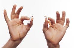 Hand crushing cigarette Stock Photography