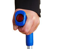 Hand on a crutch Stock Photography